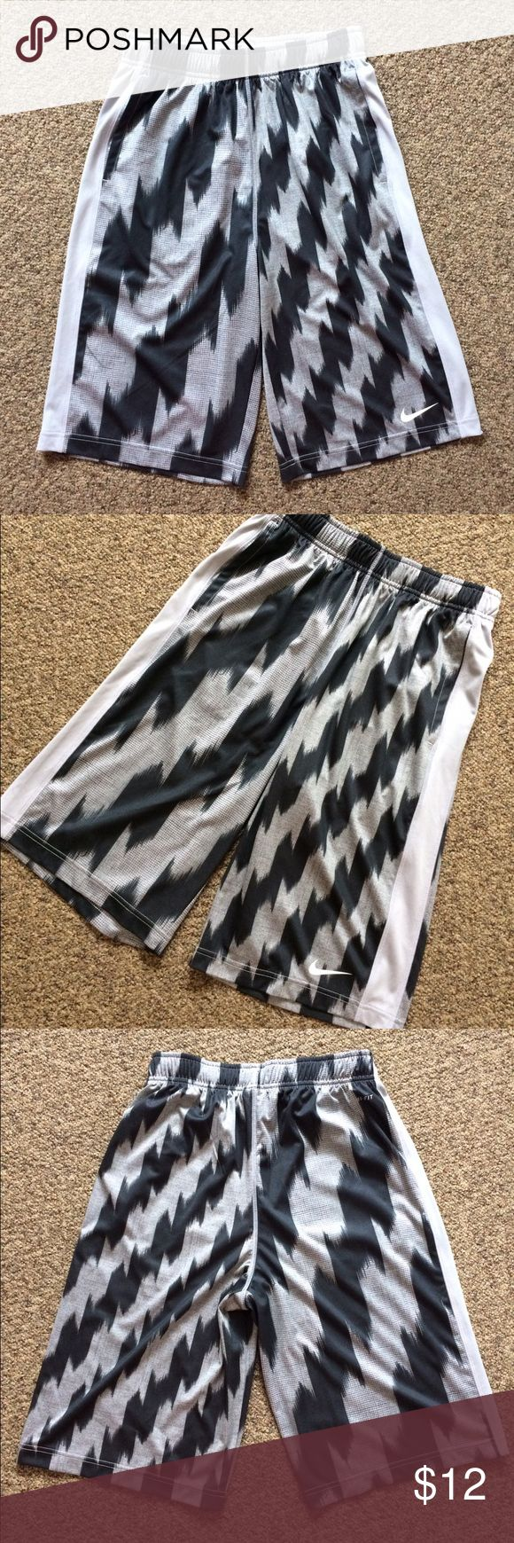 Boys Nike shorts Boys size XL youth Dri-Fit Nike shorts. EUC other than inside string is missing (see photo). Nike Bottoms Shorts