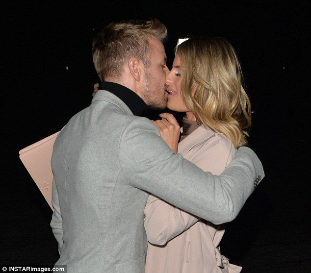 Sealed with a kiss: Danielle Armstrong was keen to show how smitten she is with her footballer boyfriend Daniel Spiller, locking lips for all to see after a date night at Maze Restaurant in Mayfair on Tuesday