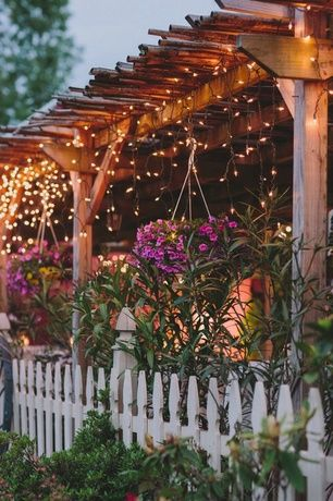 Rustic Landscape/Yard with Covered patio, Universal Forest Products Incense French Gothic Fence Panel, Outdoor lighting