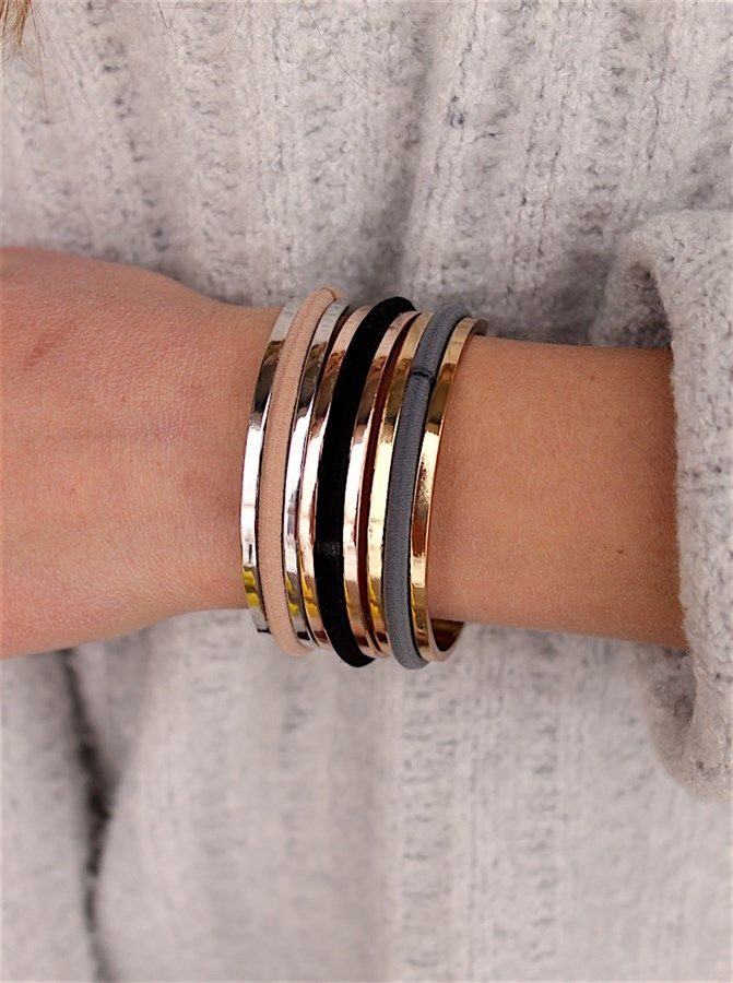 These hair tie bangles are so trendy right now! They are the perfect way to keep track of your hair ties, while also having a stylish piece of jewelry.