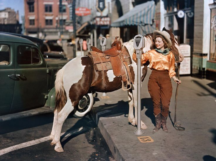 "See a photo of a cowgirl hitching her pony to a parking meter in Texas by Luis Marden, from National Geographic. A rodeo cowgirl hitches her pony at an El Paso parking meter in this picture from the October 1939 photo feature ""Riatas and Romance on the Rio Grande."""