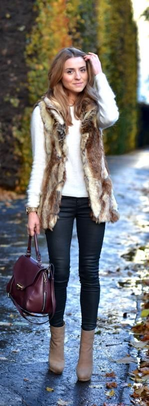 Winter fashion ideas. Fur vest, white sweater and black pants.