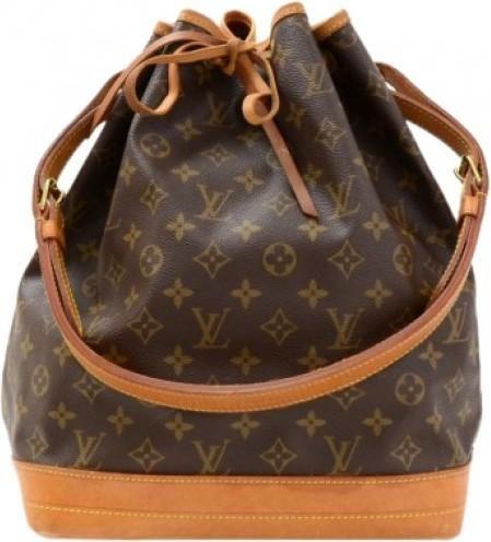 Dakota+Johnson+wearing+Louis+Vuitton+Noe+Vintage+Bag