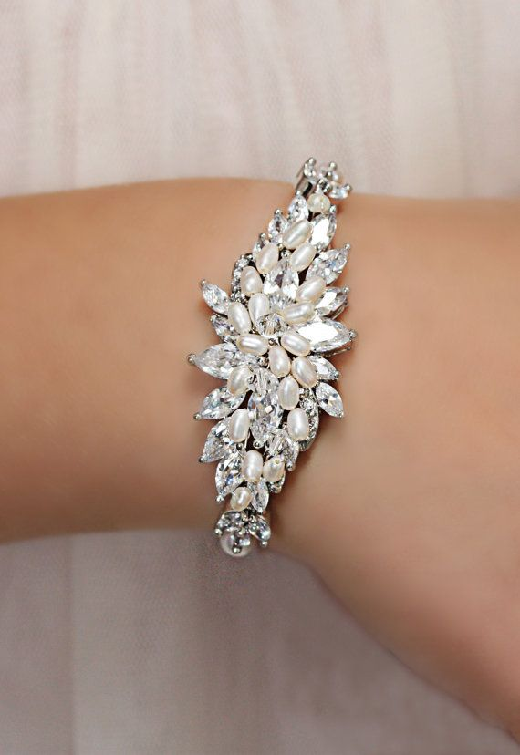 This stunning new statement bracelet is made with rhinestones, freshwater pearls and sparkly Swarovski crystals. I make this piece by hand,