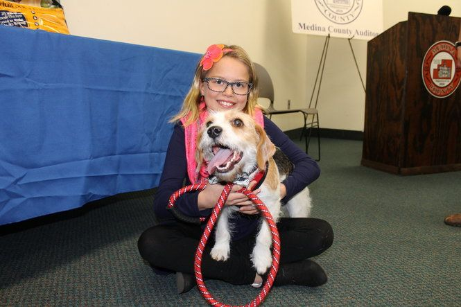 Medina County has a new Top Dog: Dexter, a beagle-dachshund mix, was the subject of Brunswick fourth-grader Adrienne Raglow's winning entry in county Auditor Mike Kovack's annual Top Dog Essay Contest.