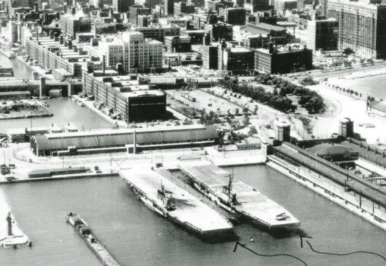 The Cornbelt Fleet (carrier training ships of the Great Lakes) at anchor at Chicago's Navy Pier. By 1943, the navy needed even more carrier pilots trained, so in May the Wolverine was joined by another flattop, the newly refurbished USS Sable.  This newer carrier had been converted from the 518-foot-long paddle-wheel liner Greater Buffalo, the former pride of the Detroit and Cleveland Navigation Company's Lake Erie fleet.