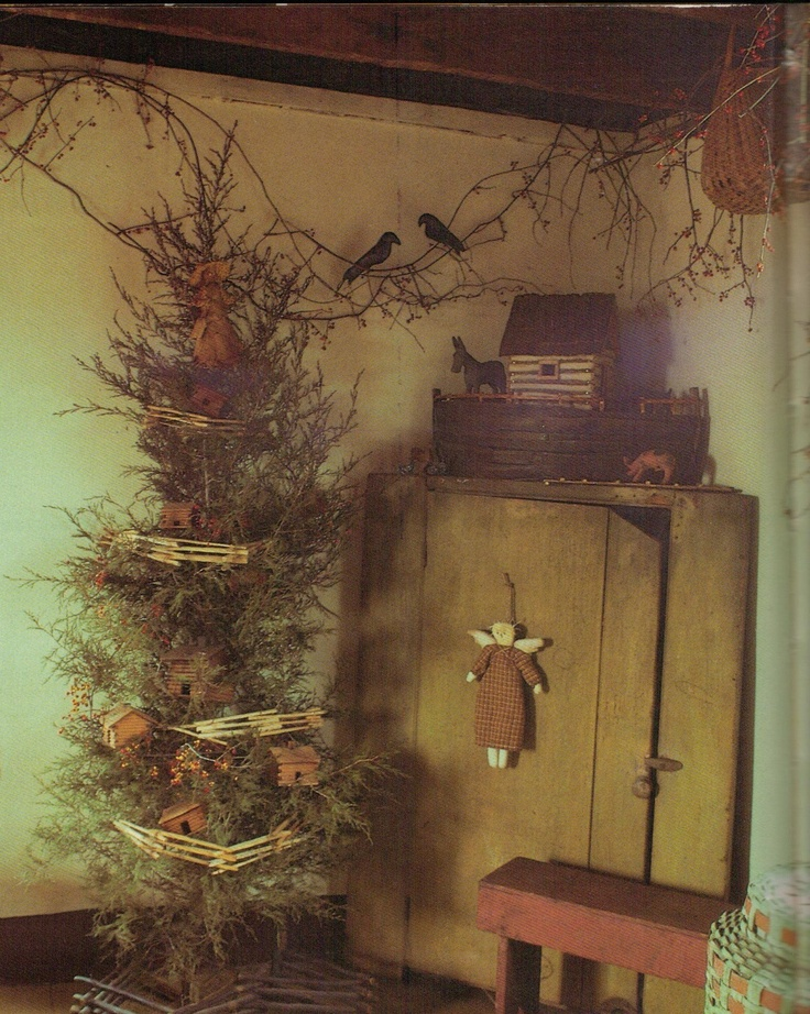 Prim Christmas...twiggy garland with crows, Noah's Ark, & old mustard cupboard with prim angel.