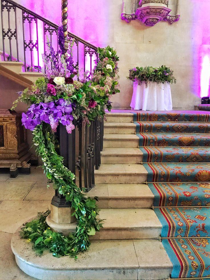 Floral stair garland at Ashridge House, Hertfordshire wedding venue