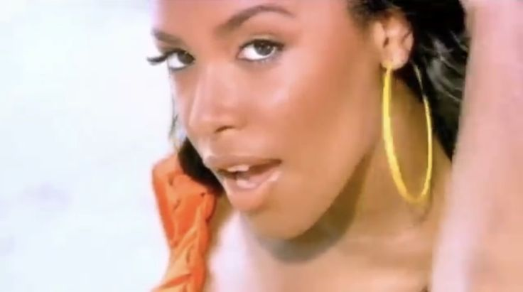 "Video screenshot of Aaliyah looking Naturally Beautiful from the ""Rock The Boat"" video"