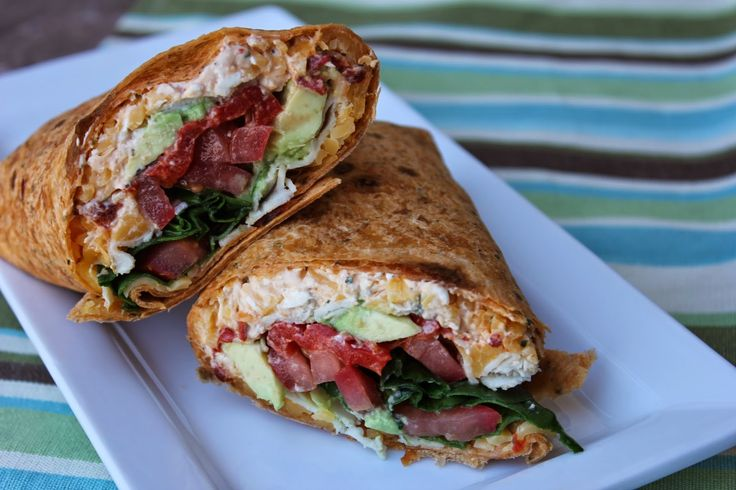 Chipotle Turkey Avocado Wraps--going on any picnics in the near future? These turkey wraps are the PERFECT solution for any take-and-go dinners or lunches. This creamy, chipotle sauces takes any wrap to the next level. These are simple and amazing for a light summer dinner!! By dealstomeals.com