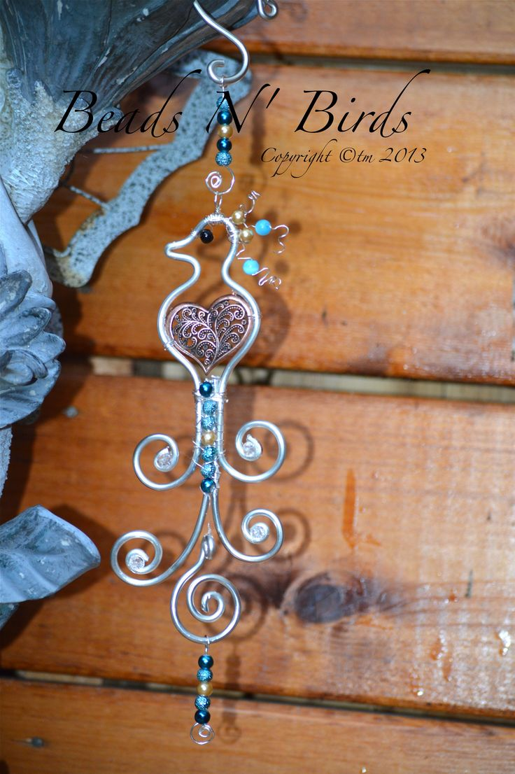 Birds: Peacock Bird: Wire Birds - Gorgeous Suncatcher created by: Coirnini Company © ™ Silver or Copper Wire. Choose your wire and bead colour. Display in a window, rearview mirror or in that perfect place you love to sit. www.facebook.com/... or www.coirnini.com Always Quality Made. xo To Purchase Our Barn Yard Birds: Email us at coirnini@gmail.com xo Pam Potts