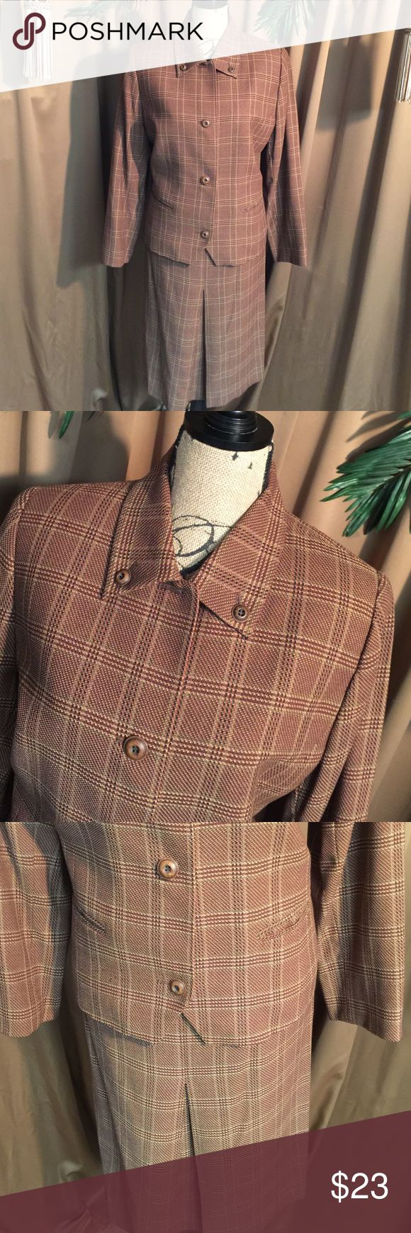 🆕➡️ 100% plaid wool 2- piece skirt suit Very nice pre-loved two-piece skirt suit 100% wool has beautiful red and brown undertones of plaid. This is a vintage suit with normal wearing but has more wearing life to it. Skirt has a deep pleat  in the front and it measures 26 inches from waist line to hemline. It has beautiful wooden buttons down the front of Jacket. The size tag is missing in the jacket but I'm sure it coincides with the size of the skirt is. doncaster Skirts Skirt Sets
