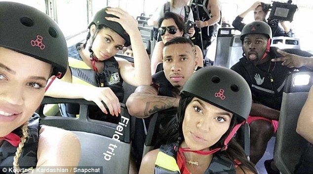 Fam time:The family was also seen wearing helmets as they rode a bus. Khloe and Kourtney were in front with Kylie and Tyga behind them. In the last row was Kris Jenner and her beau Corey Gamble