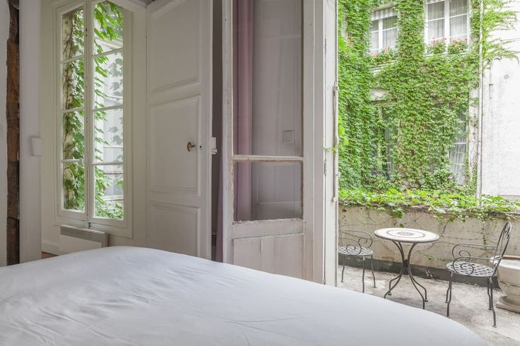 Entire home/apt in Paris, FR. In the heart of St Germain des Prés with a terrace, flowers and vines, my flat has wooden beams and high ceilings. Very bright, all the modern amenities with the charm of a parisian building. It is quiet, peaceful, on a beautiful courtyard. No noi...