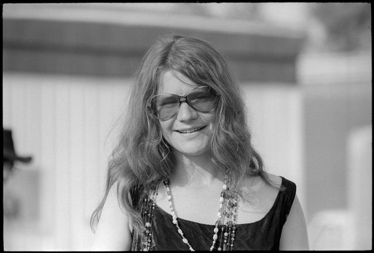 Bruce MacCallum recalls photographing Janis Joplin:  Janis Joplin at Atlanta Pop. Having met and shot Janis at a few earlier concerts, it was the first time I saw her so relaxed and happy. I was with my editor Cyn Zarco and friend Jordon. Janis was sitting on the steps of her camper talking with Al Kooper. We all began talking and I asked if we could shoot them together. That led to a few single shots of Janis. She was happy and excited about the groups that were going to be performing.