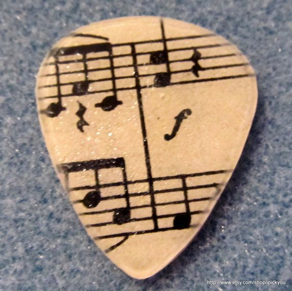 Sheet music guitar pick.