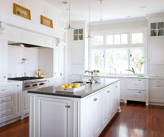 Bright-white cabinets make this classic kitchen feel fresh. More white kitchens: http://www.bhg.com/kitchen/cabinets/styles/kitchen-cabinets-in-white/?socsrc=bhgpin071112whitecabinets
