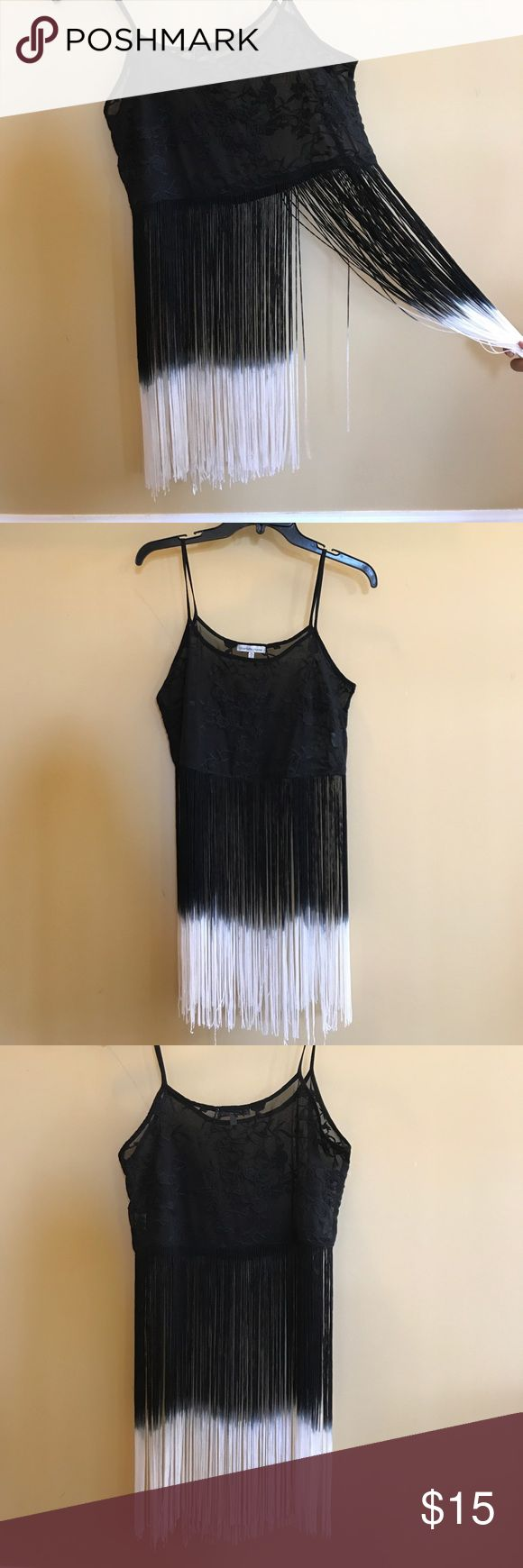 Black and white fringe spaghetti top Black spaghetti top with self embroidery transitions into a black fringe with white ends. Top is see through and best teamed with a cute bra or bralette. Never worn!! Charlotte Russe Tops