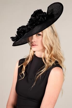 This year's big black hat!  Mottisfont is a fine black straw, edged in black silk satin and trimmed with large black silk satin roses.  Slashed at the back for asymmetry it's worn strongly tipped.