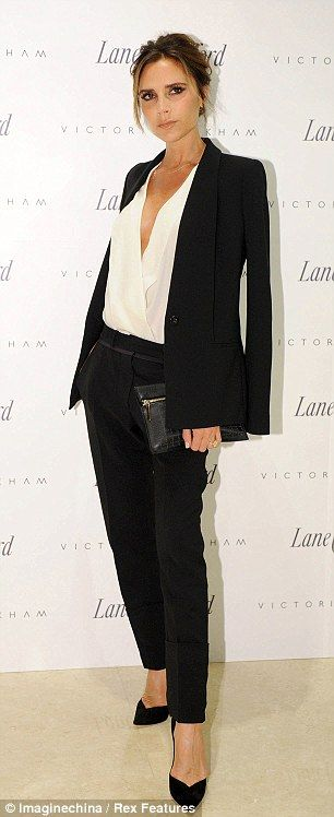 Victoria Beckham looked flawless in a black trouser suit over a low cut white blouse at the launch of her autumn/winter 2013 collection in Beijing