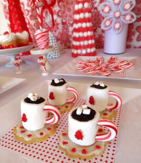 HOT COCOA MARSHMALLOWS Candy * Make a cup out of marshmallow on a cookie with a candy cane handle.  Could also make a tea party themed cup. http://partypinching.com/parties-holidays/christmas-dessert-table-red-white-sweet-dreams/