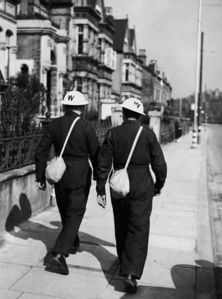 Air raid wardens in Lambeth, 29th March 1940. Their helmets are newly painted white for visibility at night or during the black-out. (Photo by Harry Todd/Fox Photos/Hulton Archive/Getty Images)