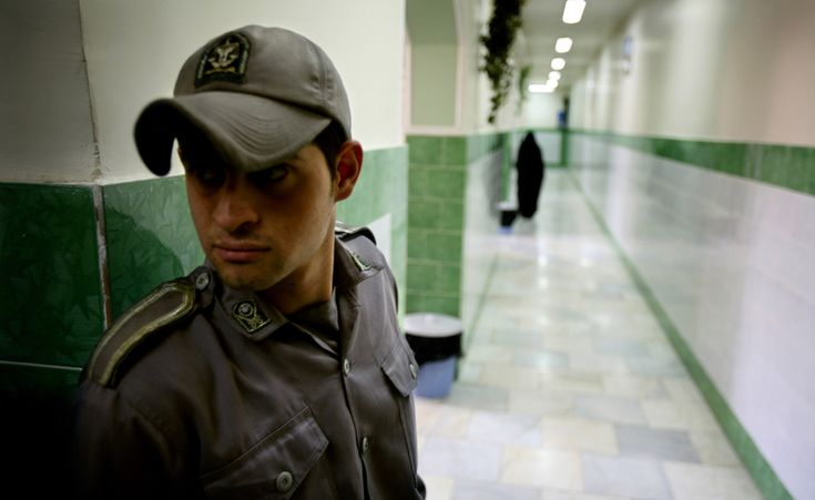 A prison guard stands along a corridor in Tehran's Evin prison in this June 13, 2006 file photo. -- Muslim Iranian Interrogator Persecuting Christians Gives Life to Christ After Christian Prisoner in Solita http://po.st/NgIYOv via @po_st