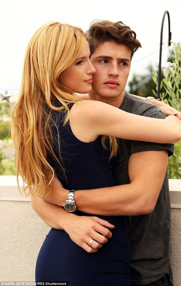 Making it official: Bella Thorne cuddled up to her boyfriend Gregg Sulkin as she promoted ...