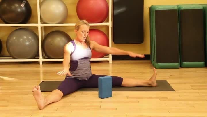 A Yin Yoga Shoulder Pose Using a Block | eHow