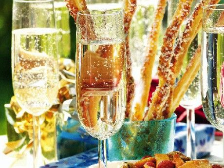 Cold champagne served with snacks