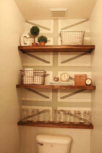 built-in shelves between narrow wall area. Make a design in the background to make it stand out. =)