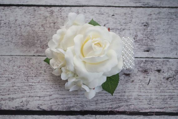 The Ivory Rose and Hydrangea Wedding Corsage is elegant and traditional, perfect for a mother or grandmother in your wedding party. Rose color can be