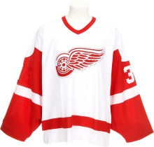 """2003-04 Dominik Hasek Game Worn Detroit Red Wings Jersey. This jersey, worn by one of the game's most prominent goaltenders (""""The Dominator"""") is an example of one of the most classic hockey uniforms thinkable."""