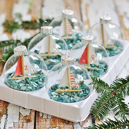 DIY Christmas Ornaments | Nautical or nice? This holiday season, learn to make these adorable sailboat ornaments by Kim at Sand and Sisal -- a perfect gift for any seafaring enthusiast!