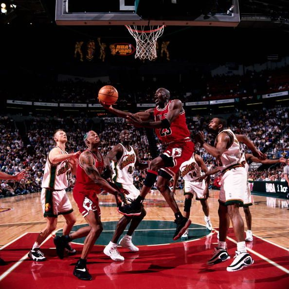Michael Jordan of the Chicago Bulls drives to the basket for a reverse layup against the Seattle Sonics during Game four of the 1996 NBA Finals at...