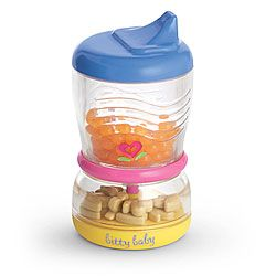 "New!  Bitty Sip & Snack Cup  Item# F1031  Bitty Baby can take her snacks on the go! This two-piece, stacking cup pulls apart to reveal a sippy filled with faux orange juice and a snacker with bear-shaped ""cookies"" inside.   $10"