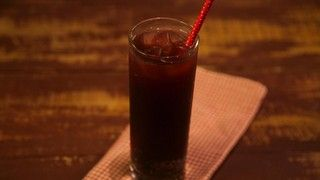 Dr Pepper-like CARLA HALL Makes 2 1/2c water 1/2c br sugar 1t wh cloves 2t wh blk peppercorns 1 cinnamon stick 1/2t vanilla ext 1/8t almond ext 1c frzn cherries soda water (to serve) Heat in saucepan (medium) H2o & sugar to a boil. Add rest of ingredients & bring to simmer for 15-20 minutes til syrupy. Remove from heat, strain & allow to cool Serve: Pour 1/4 c syrup into a tall soda glasses. Top with soda water and stir Store syrup in airtight container for 2 wks in frige