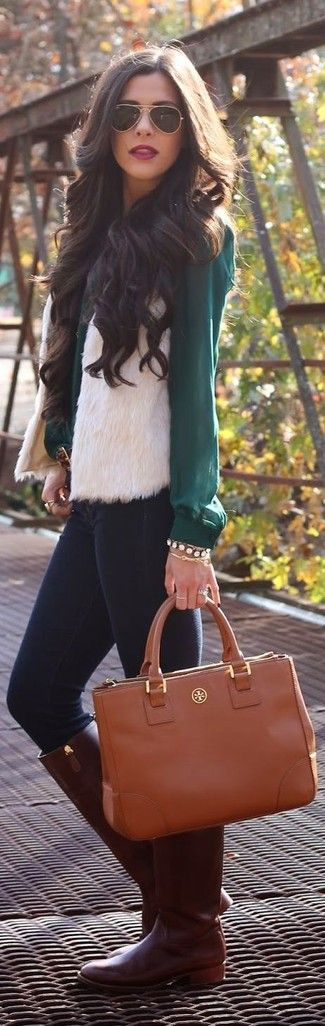 Women's Dark Brown Leather Knee High Boots, Brown Leather Tote Bag, Navy Skinny Jeans, Gold Bracelet, White Fur Vest, Teal Button Down Blouse, and Black Sunglasses