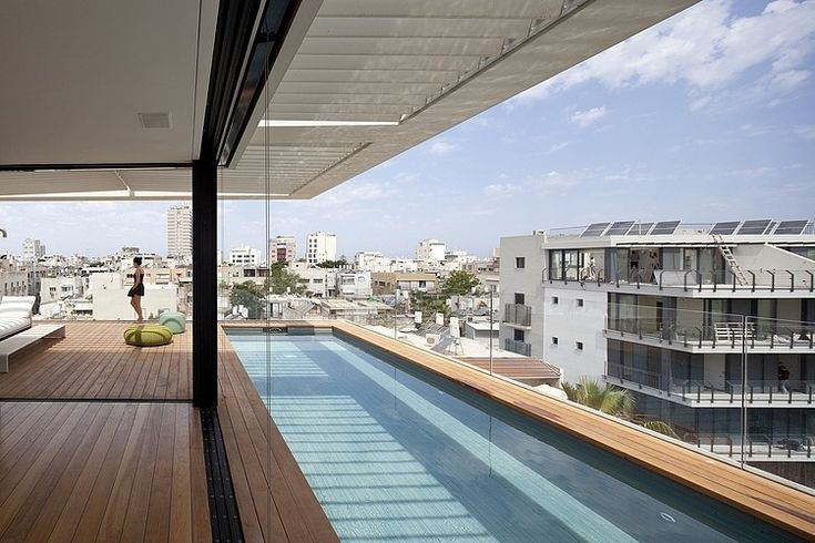 You can apply our scellant protector on wood, around your pool. Photo: Tel Aviv Townhouse by Pitsou Kedem Architect