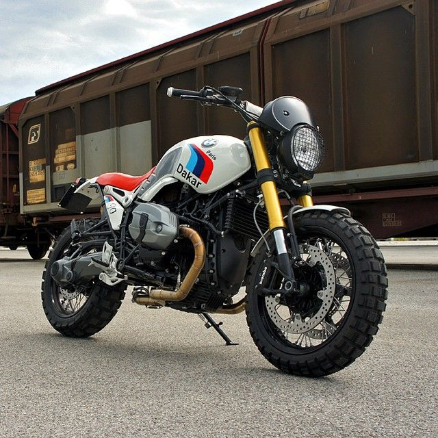 Word on the street is that BMW will soon launch a scrambler version of the R nineT. We're hoping it looks as good as this Dakar-themed custom from @luismoto of Italy. He's reworked the R nineT into a modern version of the iconic R80G/S Paris Dakar, complete with motorsport graphics and that classic red seat. And the stainless steel, two-into-one exhaust system is absolutely … Fantastisch. #MakeLifeARide #scrambler Get the full specs and high-res images at…