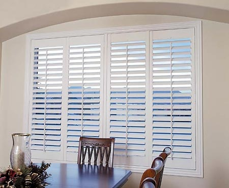 Wide louvered plantation shutters are natural choices for rooms with stunning…
