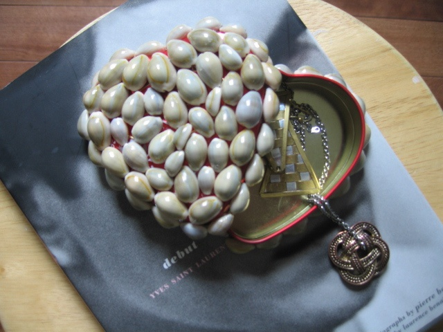 DIY Jewelry box using heart shaped chocolate tin box and shells.