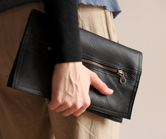 A medium clutch bag, made of black thick leather. Close with zip, with two pockets on cards. No lining. Dimesions: height: 32 cm/ 12,5 witdht: 26 cm/ 10   For these bag, please expect 1 week for your item to be made and prepared for shipment!  Standard delivery time:  European union: 4 - 10 days  Europe (not EU): 7 - 14 days  U.S.A., Canada: 10 - 20 days  Australia, South America, Asia, India, North Africa: 1 - 3 weeks  We send all items with priority air mail and tracking number.