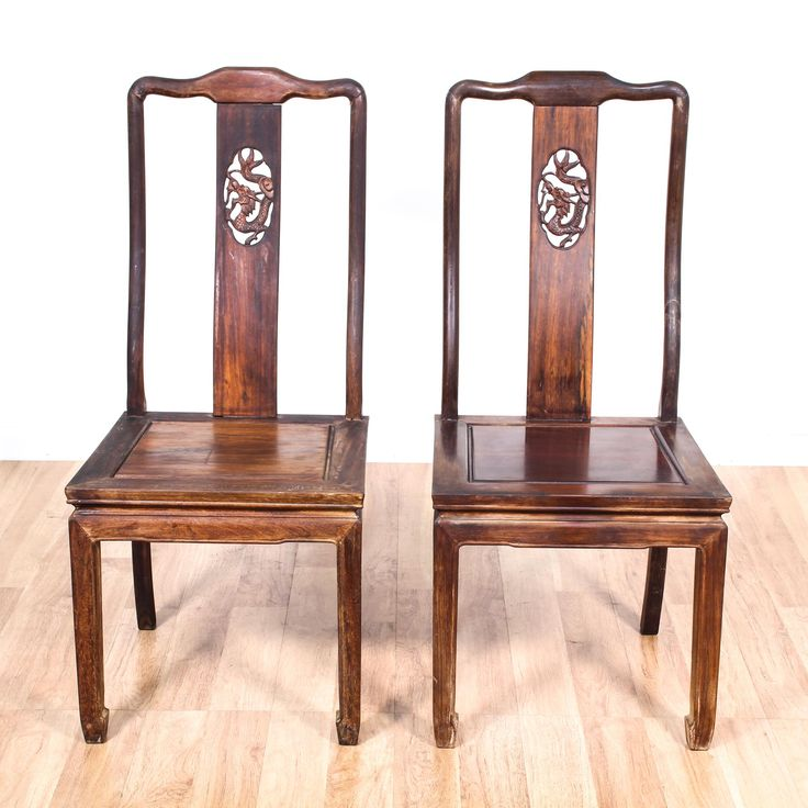 These antique Chinese dining chairs are featured in a solid wood with a distressed mahogany finish. Each Asian side chair has a carved dragon design on its splat, h-stretchers, and horseshoe feet. An elegant addition to the dining room! #asian #chairs #diningchair #sandiegovintage #vintagefurniture