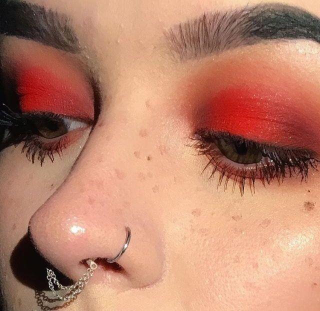 red smokey eye, fake freckles, nose ring