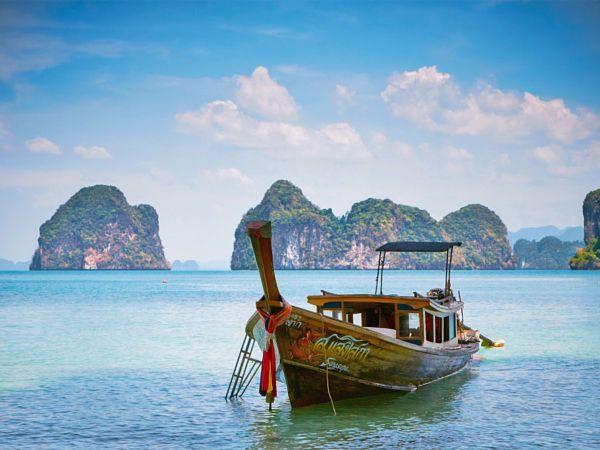 Copyright, 2016. Natalie Uscinas. Longtail boat at islands near Krabi, Thailand.