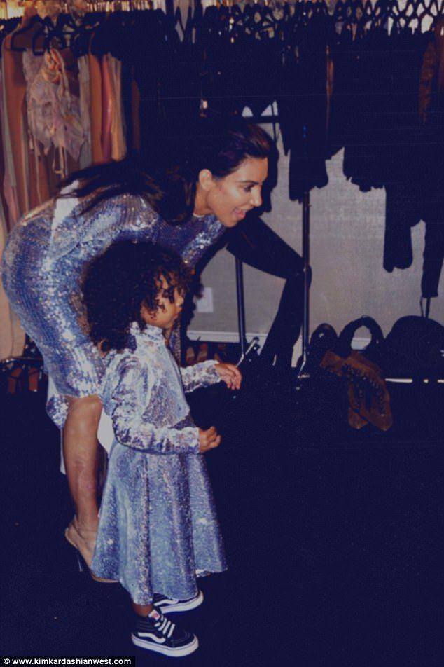 Kim Kardashian shares photos of North backstage at Kayne's show #dailymail