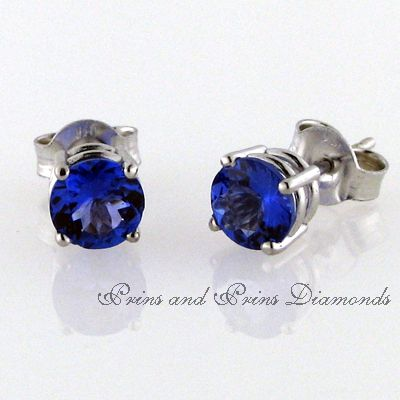 18ct white gold tanzanite 4 claw stud earrings. 2x 0.50ct round brilliant cut tanzanites are set in a classic claw.  We have a wide selection in our showroom. Contact us to ask for quotes on various sizes.