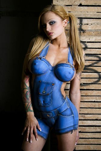 Sexy woman wearing nothing but blue paint . More sexy models at http://sexy-calendars.net