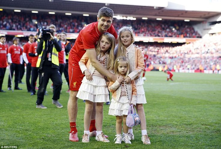 Gerrard poses with his daughters Lexie (left), Lilly-Ella (back right) and Lourdes (front ...